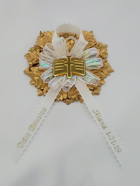 Bible on Iridescent Bow with Gold Carnation Capia